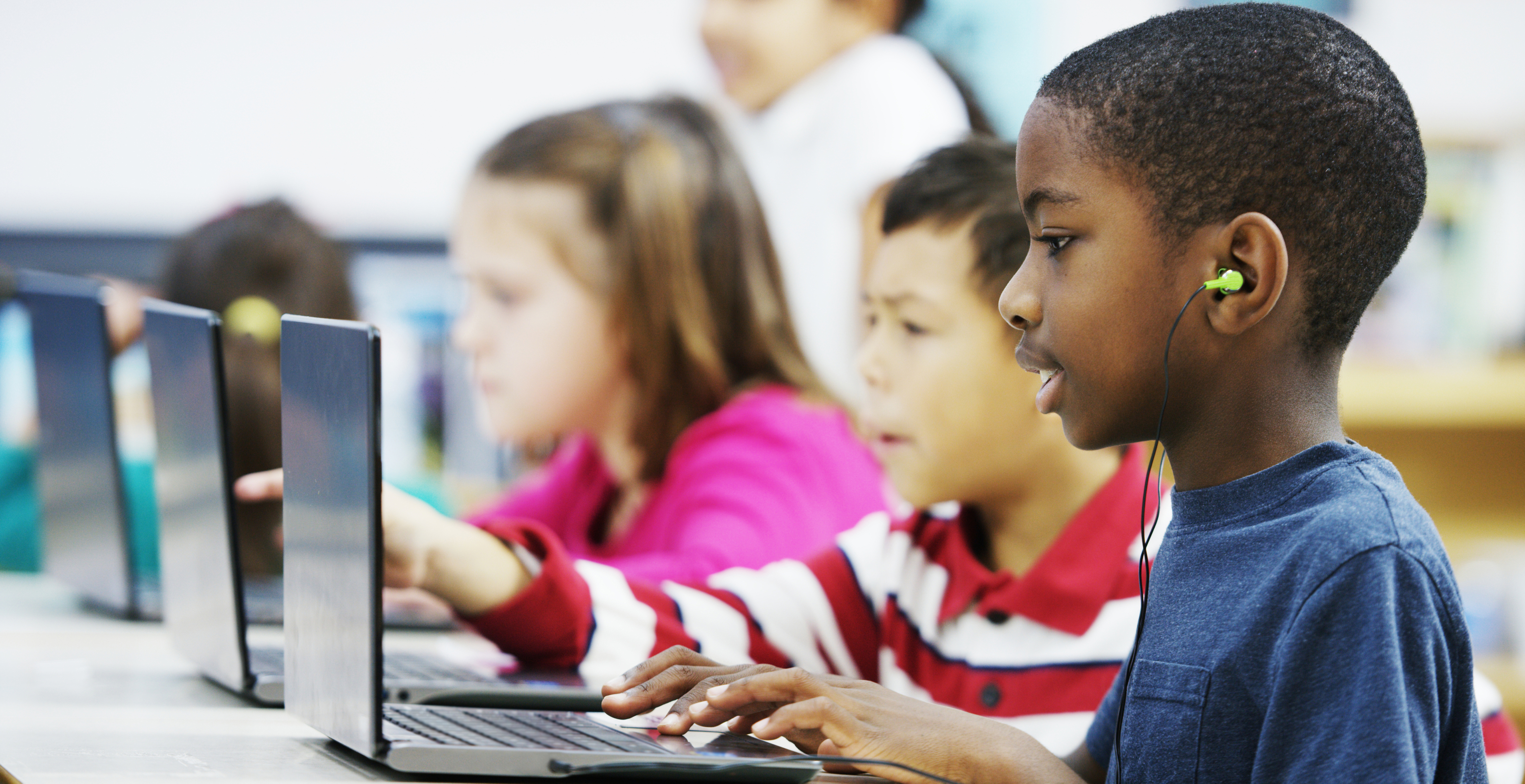 image of students on computers