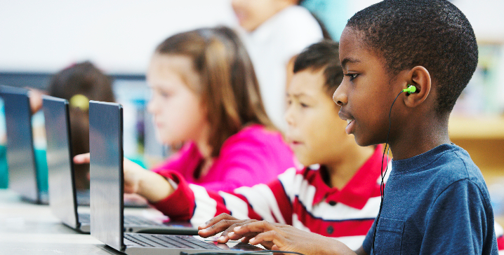 Image of students on computer