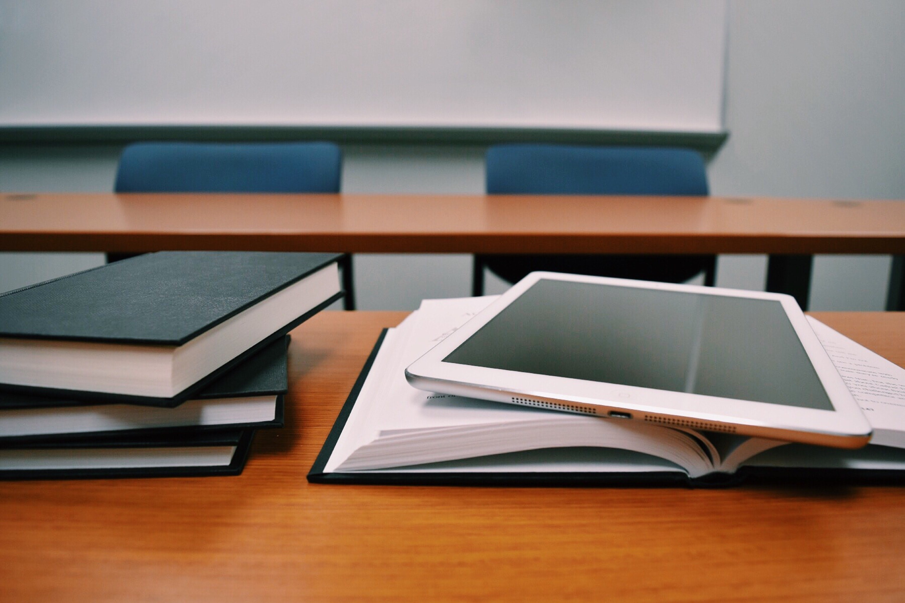 image of textbooks and ipad