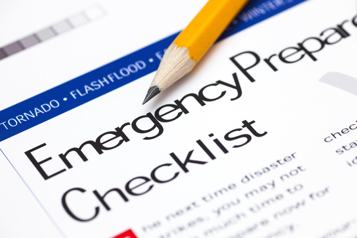 "A pencil lays on top of a document that says, ""Emergency Preparedness Checklist""."