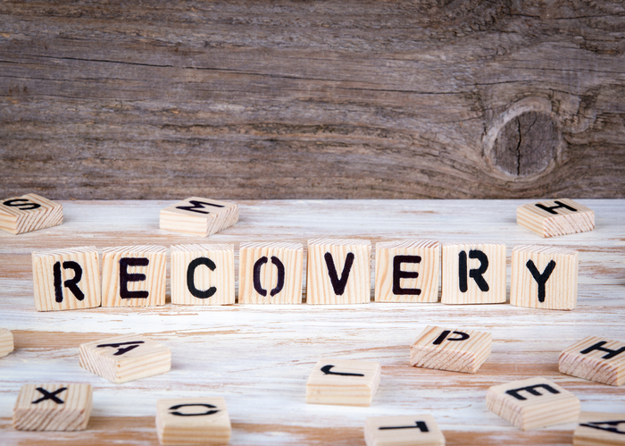 "The word ""Recovery"" is spelled out with scrabble letters."