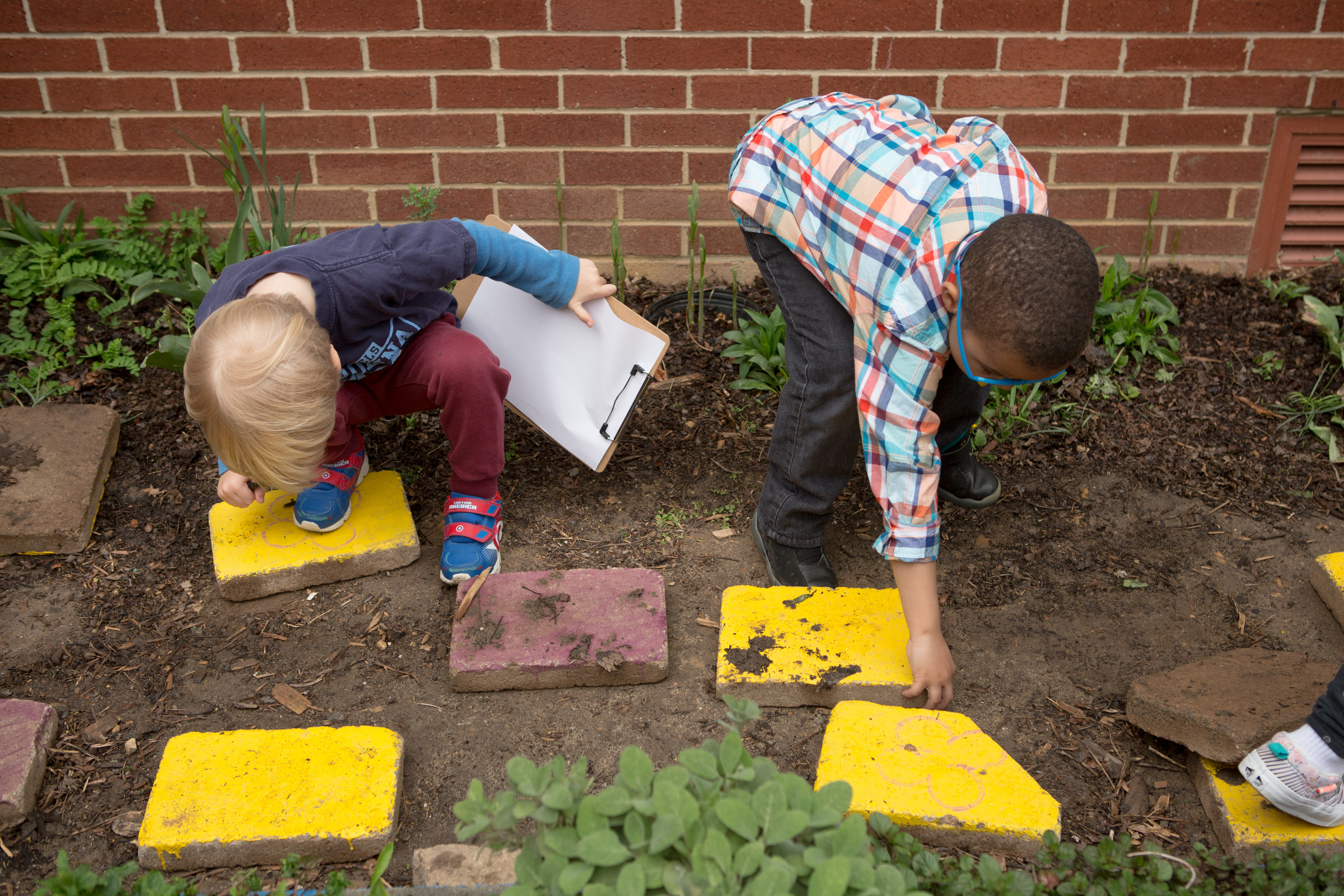 image of students in the garden